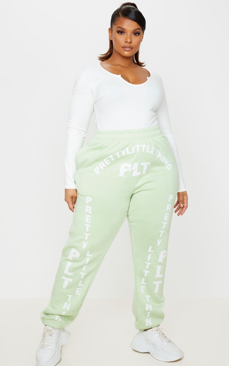 PRETTYLITTLETHING Plus Mint Green Slogan Printed Joggers 1
