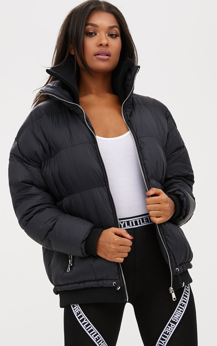 Black Oversized Puffer Jacket with Zip Pockets 1