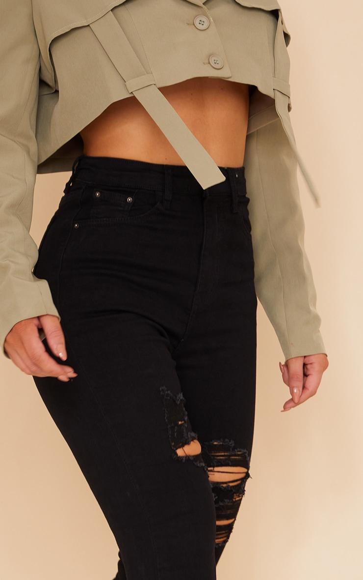 PRETTYLITTLETHING Black Ripped Hem Jeans 4