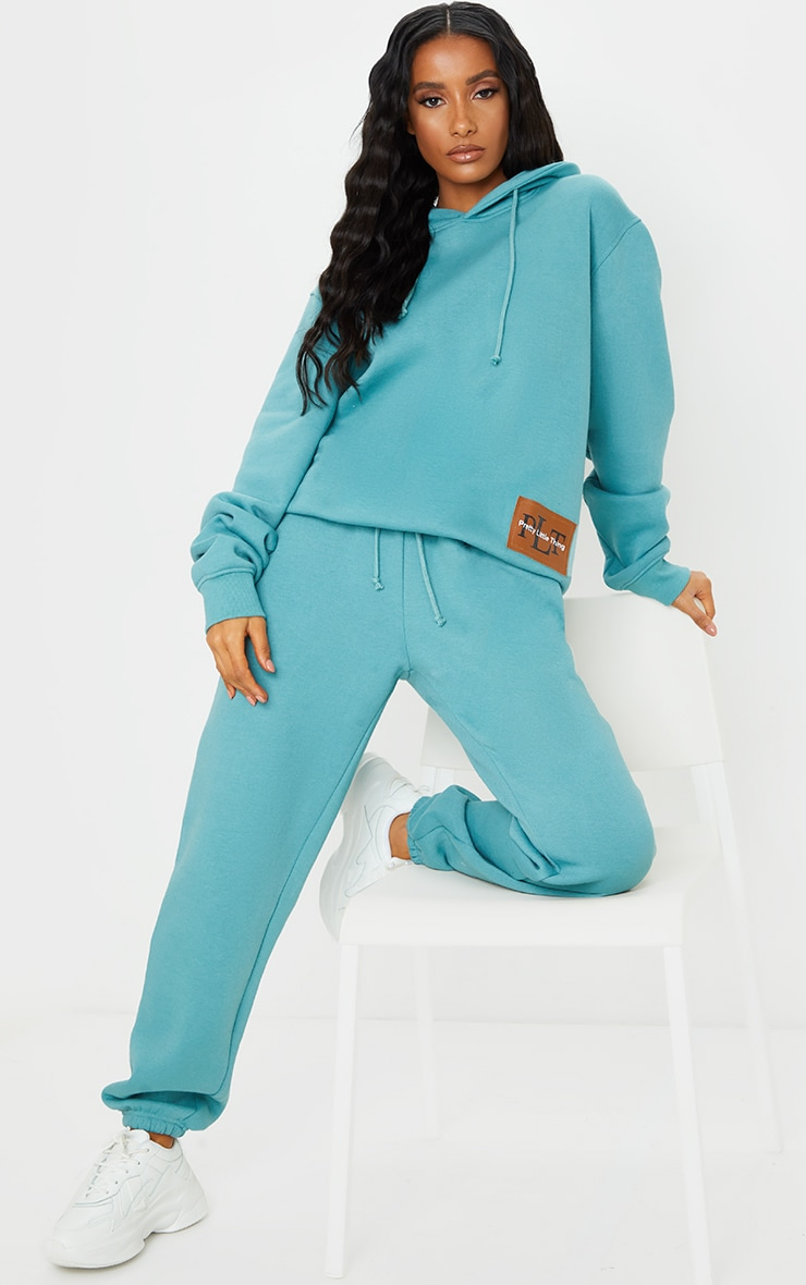 PRETTYLITTLETHING Turquoise Badge Oversized Hoodie 1