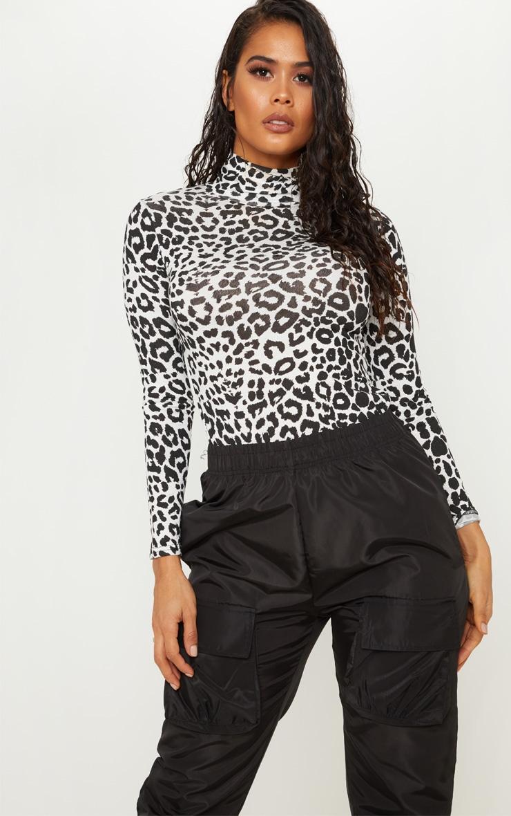 0ff428feba1d Black Dalmatian Printed High Neck Top   Tops   PrettyLittleThing