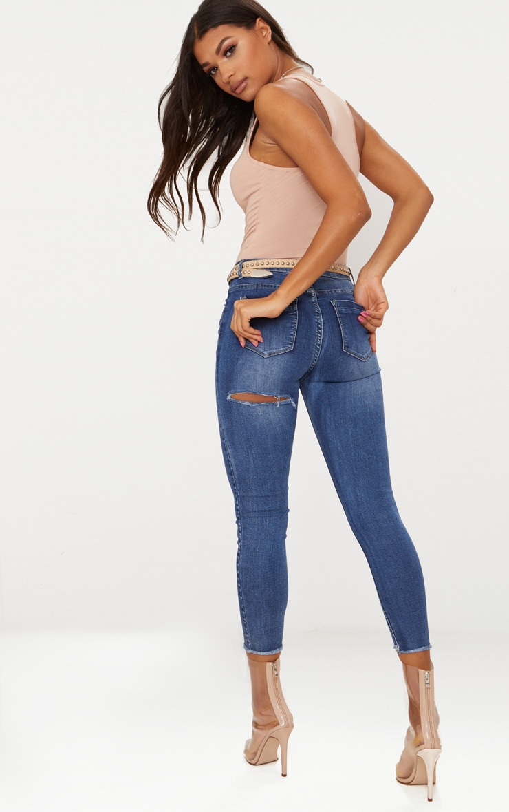 Mid Wash 5 Pocket Bum Rip Skinny Jean 1