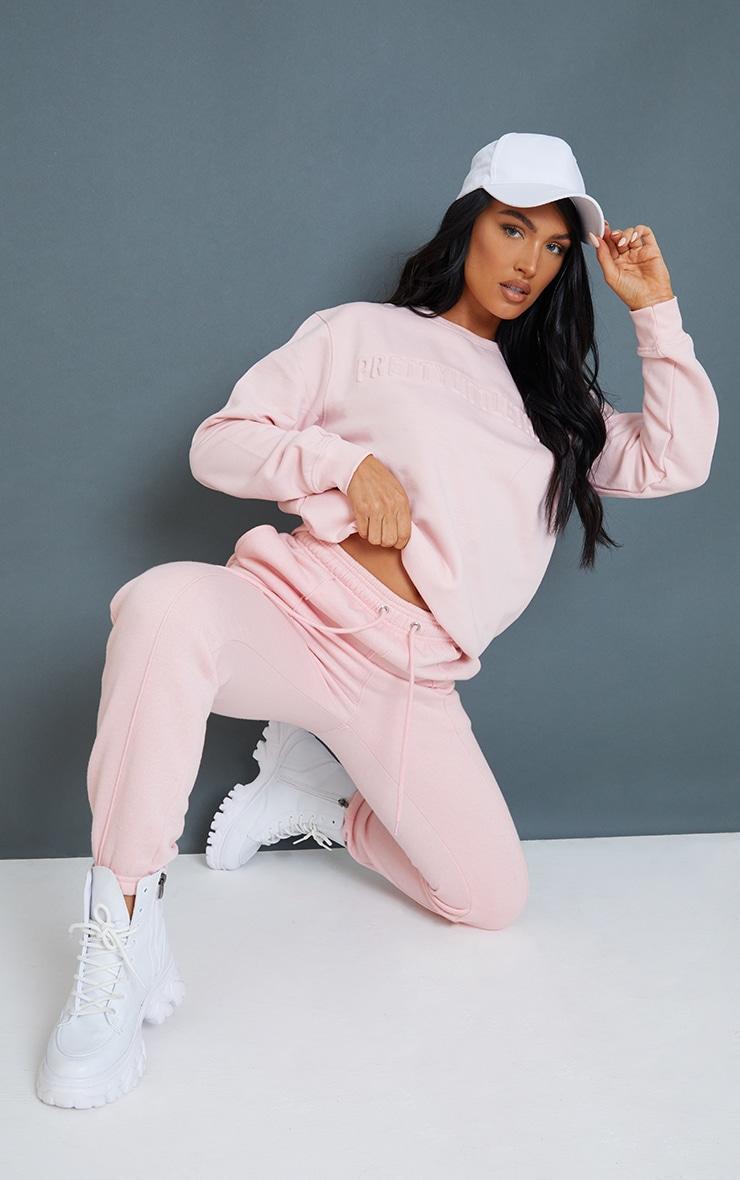 PRETTYLITTLETHING Baby Pink Embossed Sweatshirt 3