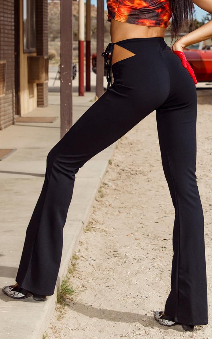 Pantalon évasé noir à détail string 3