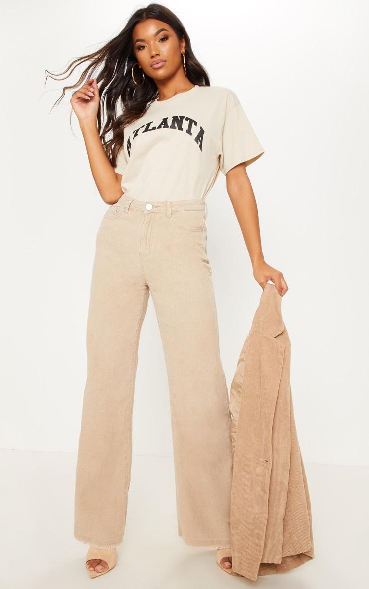 Pantalon en velours côtelé gris pierre à jambes évasées
