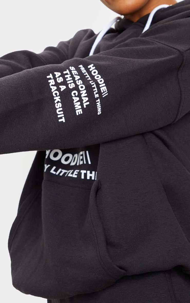 PRETTYLITTLETHING Black Oversized Slogan Print Pocket Front Hoodie 4
