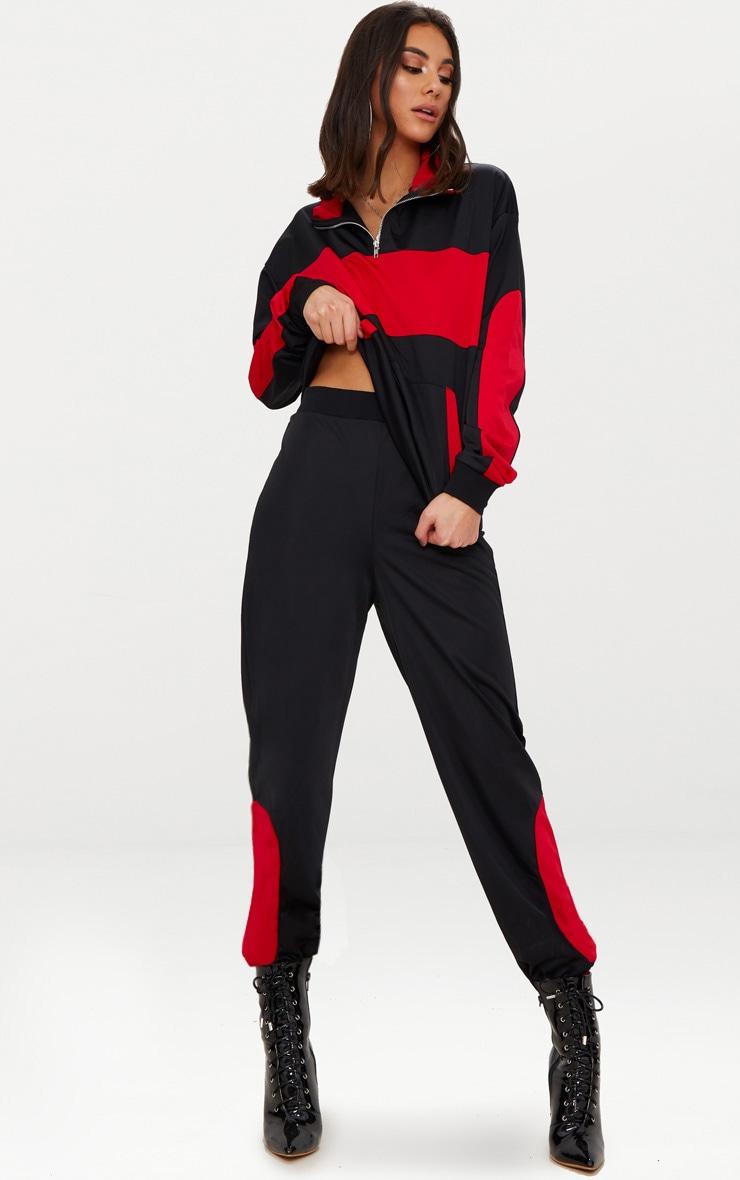 Pantalon de jogging noir à bandes rouges 18d838ed553