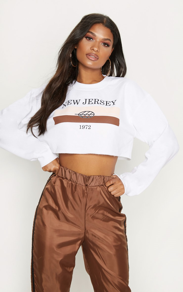 white-printed-new-jersey-cropped-sweater by prettylittlething