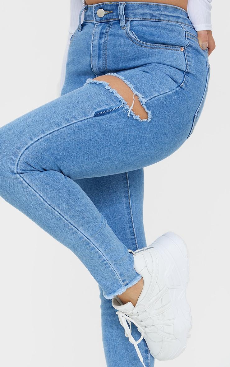 PRETTYLITTLETHING Petite Blue Thigh Rip Raw Hem 5 Pocket Jeans 4