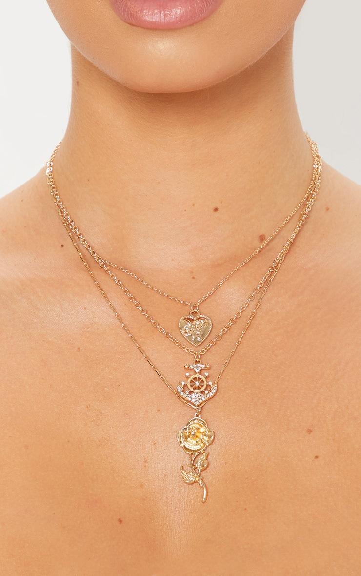 Collier doré à 3 étages avec pendentifs rose & ancre 2