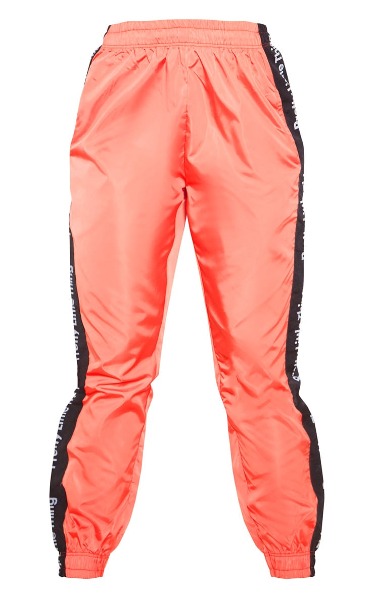 PRETTYLITTLETHING Orange Side Tape Shell Jogger 3
