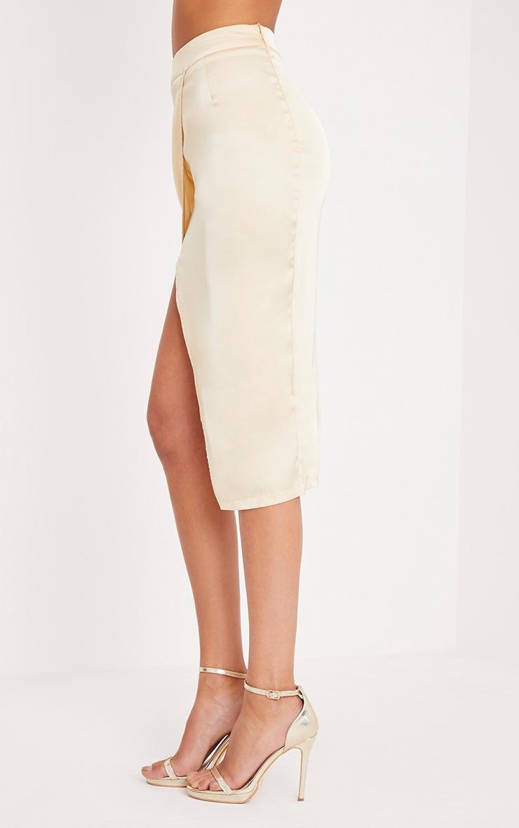 Shreya jupe drapée portefeuille en satin champagne  4