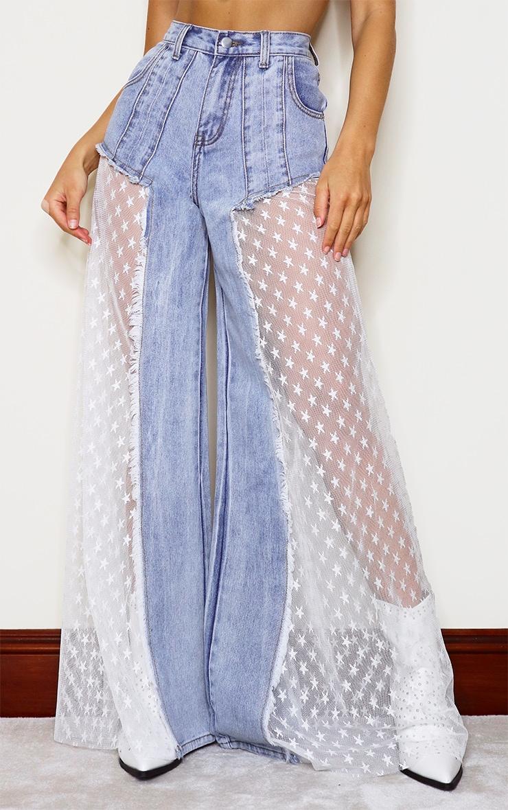 Jean ample bleu moyennement délavé à parties mesh avec étoiles en sequins 2