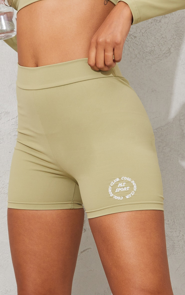 PRETTYLITTLETHING Olive Sport Cool Down Ruched Bum Cycle Shorts 5