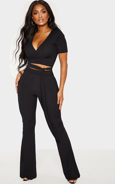 fb2874c8ae Shape Black High Waisted Ribbed Flared Trouser PrettyLittleThing Sticker