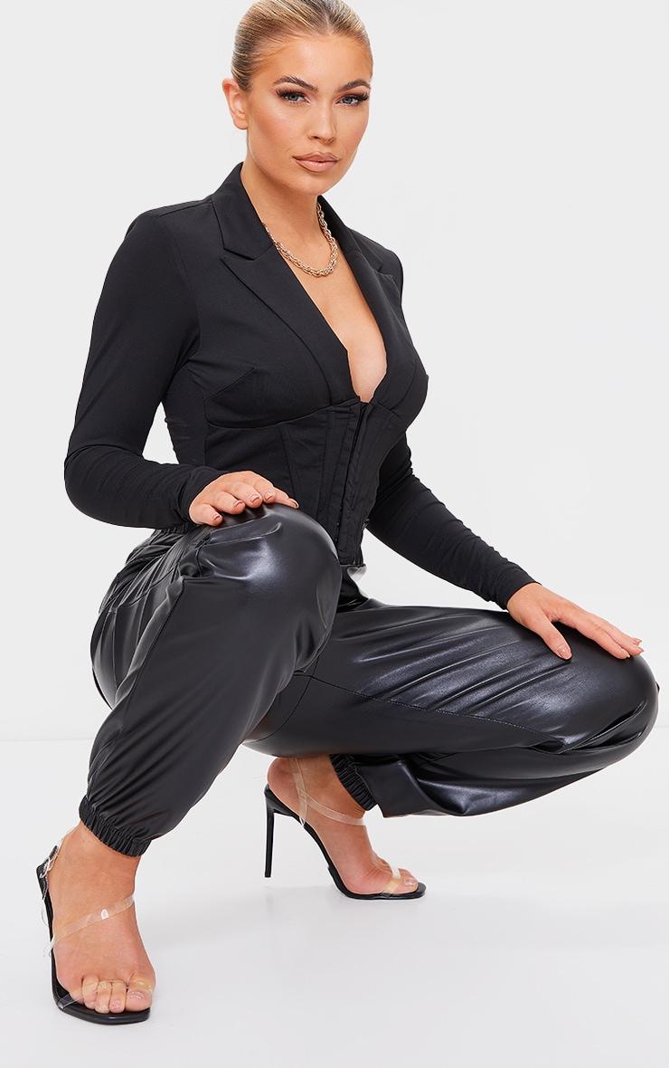 Sandales transparentes en similicuir noir à brides asymétriques 1