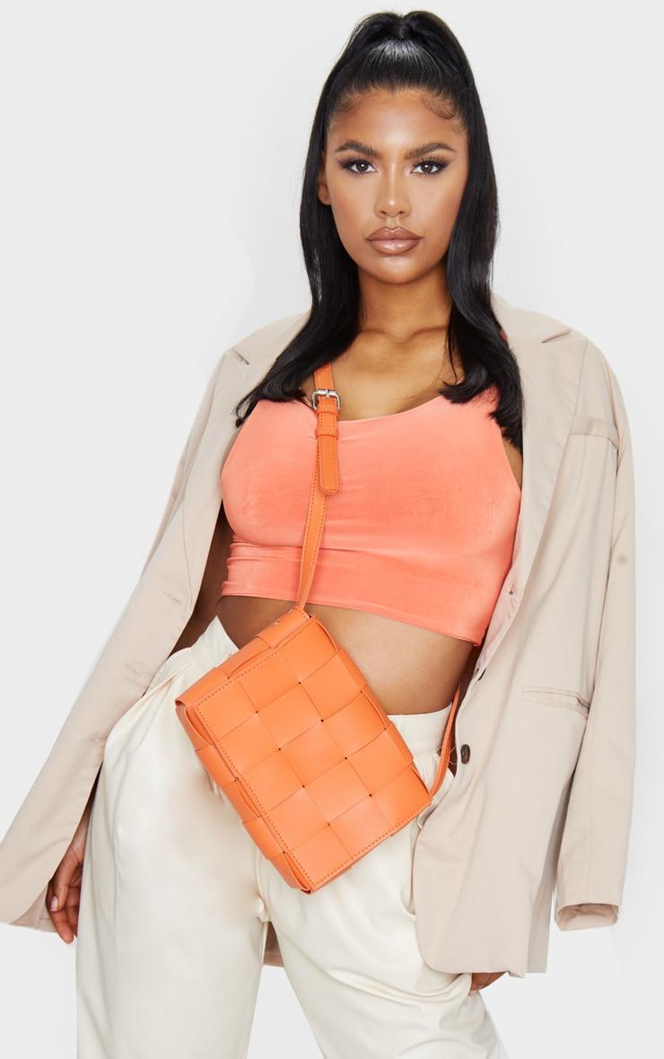 orange oversized weave cross body bag