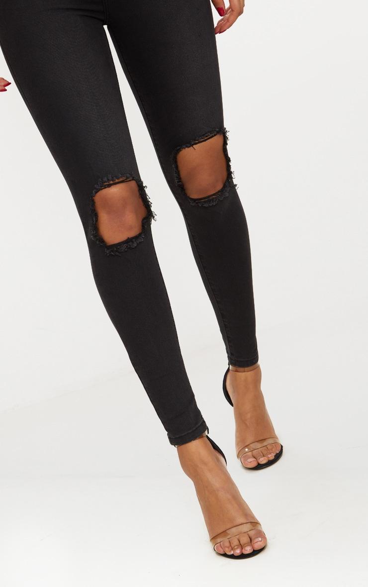 Jean skinny noir délavé ouvert au genou avec 5 poches 5