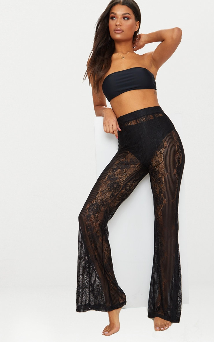 Pantalon flare en dentelle noire 1