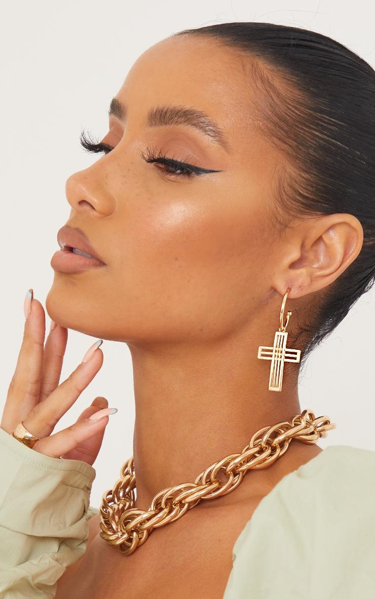 Créoles dorées à pendentif croix découpé 1