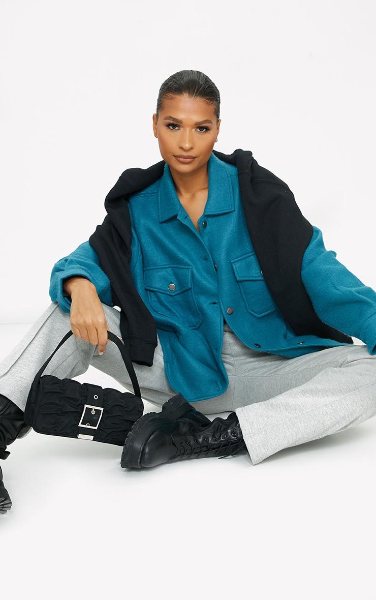 Veste style chemise bleu sarcelle à poches devant 3