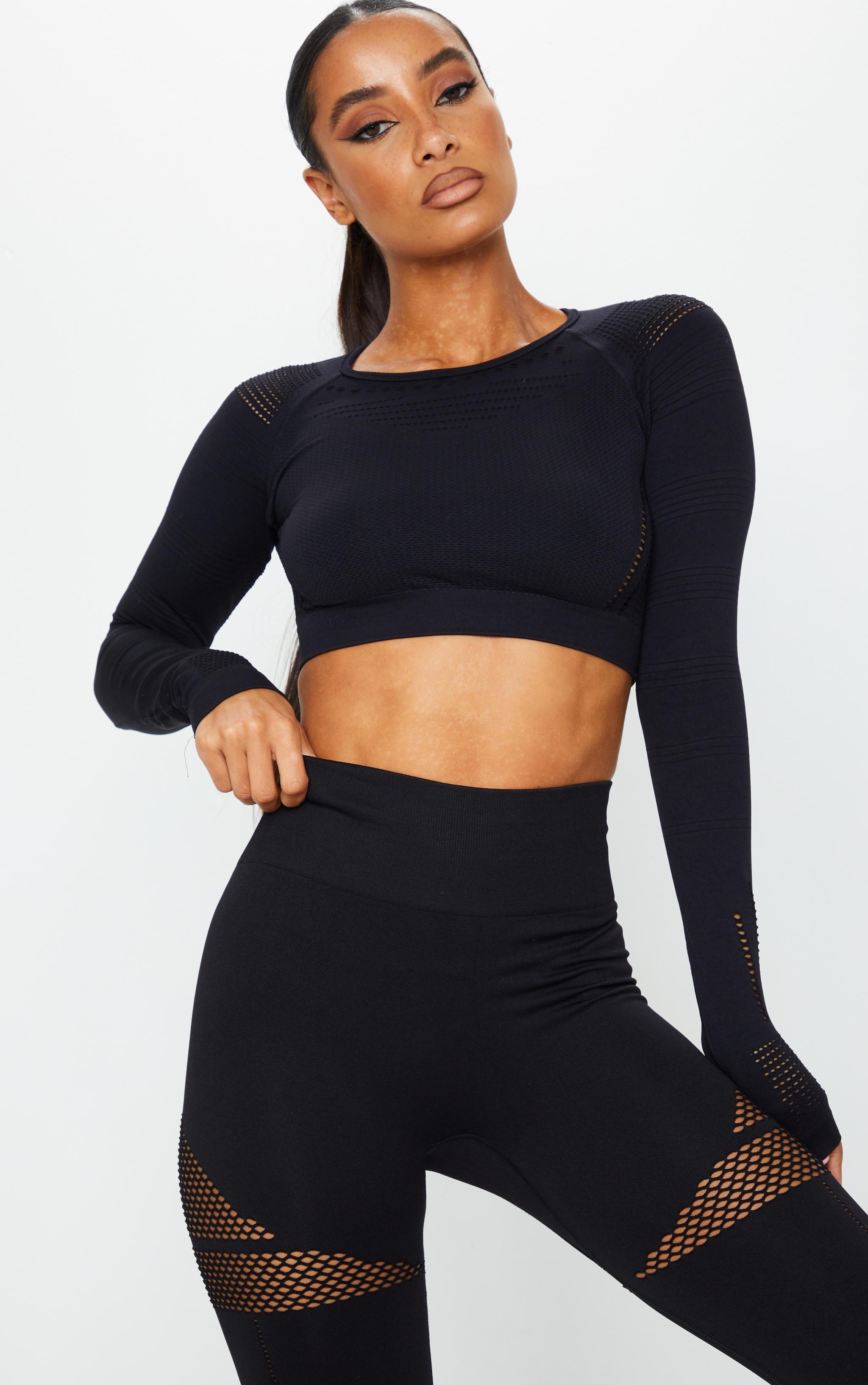 PRETTYLITTLETHING  - Top de sport noir découpé à manches longues sans coutures 1
