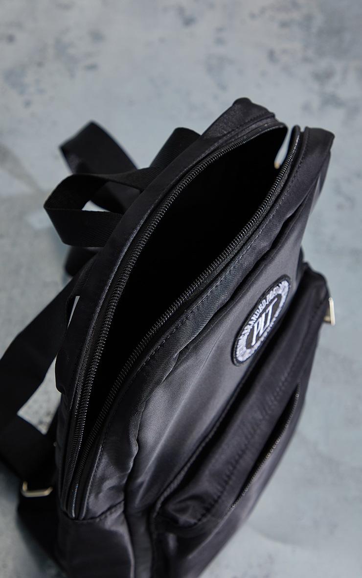 PRETTYLITTLETHING Black Round Badge Backpack 4