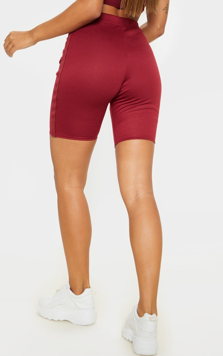 PRETTYLITTLETHING Maroon Side Tape Cycle Short  4