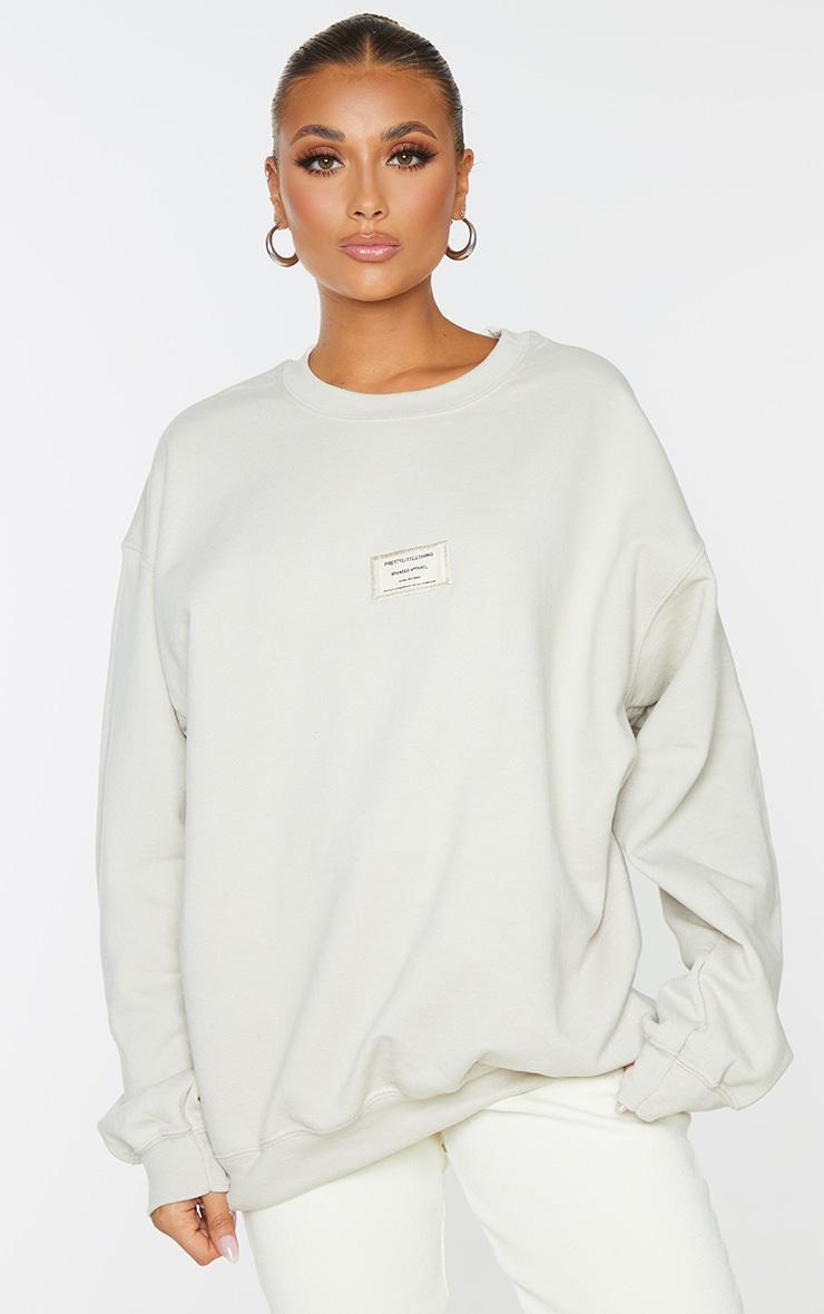 PRETTYLITTLETHING Stone Branded Apparel Woven Badge Sweatshirt 1