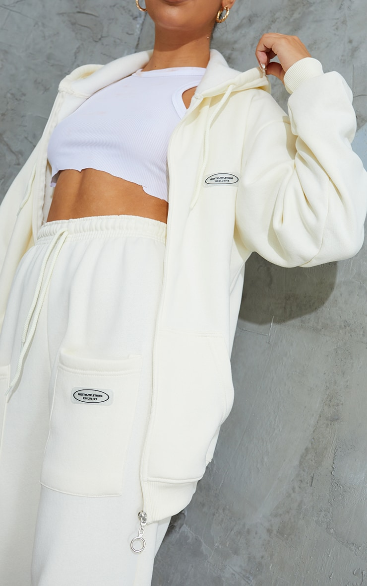 PRETTYLITTLETHING Cream Exclusive Badge Detail Zip Through Hoodie 4