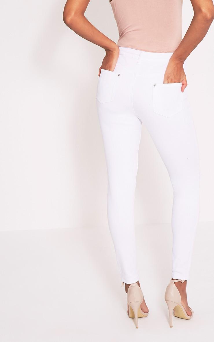 Kim jean slim blanc déchiré aux genoux 5