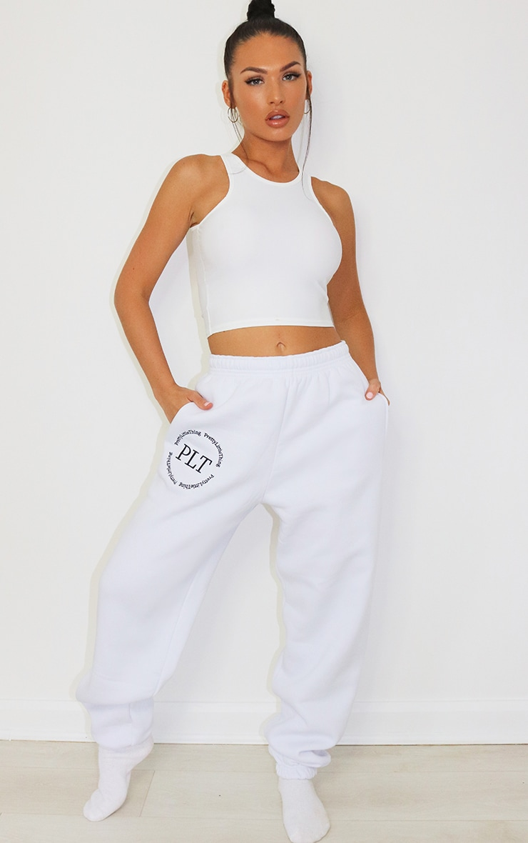 PRETTYLITTLETHING White Circle logo Embroided Detail Joggers 1