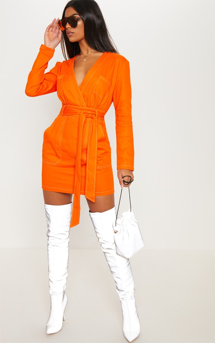 Robe moulante orange à poches et coutures contrastantes