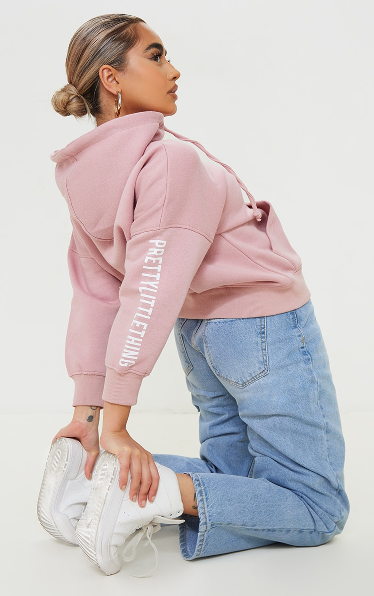 PRETTYLITTLETHING Petite Pale Pink Graphic Hoodie 1