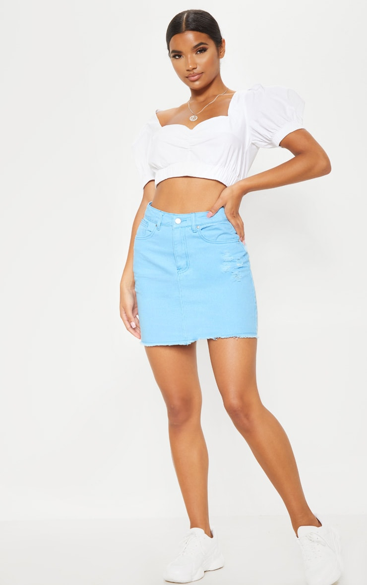 Mini-jupe en jean bleu pâle déchirée  4