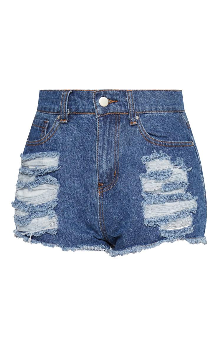 Mini short en jean bleu délavé et déchiré aux fesses 3
