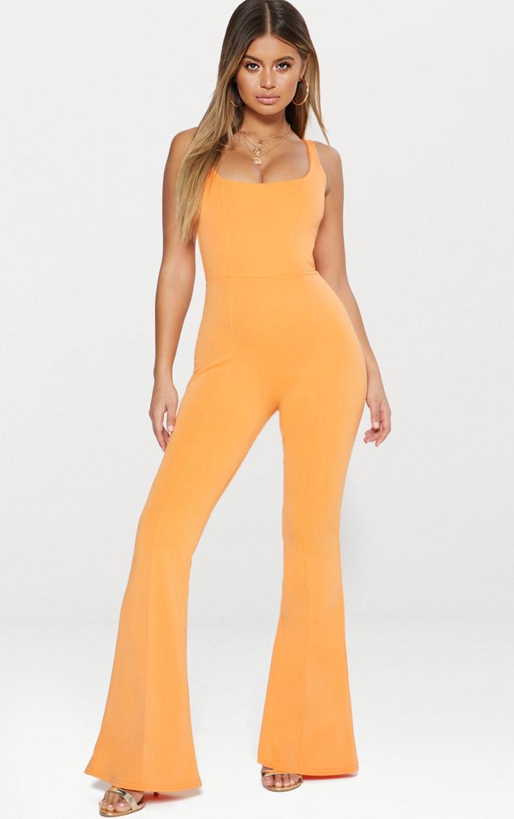 Combinaison orange à encolure carrée et coutures apparentes 1