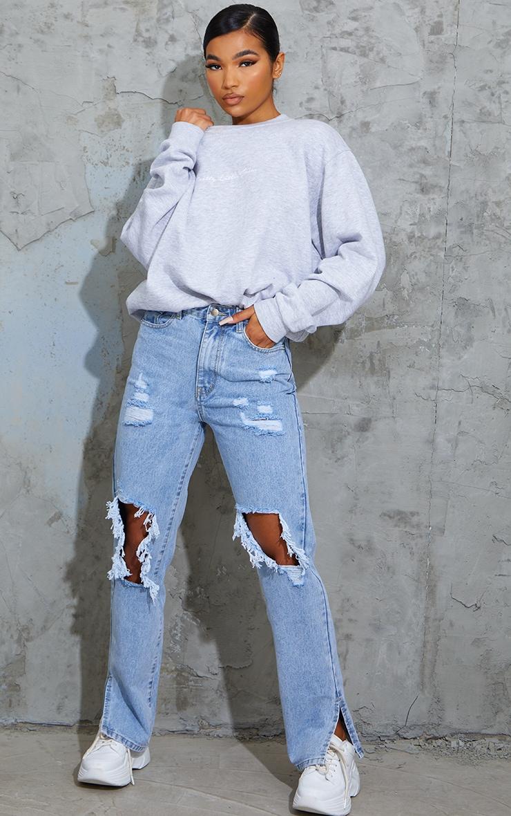 Light Blue Wash Ripped Open Knee Split Hem Jeans 1