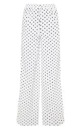 8d2dc58a78501 Pantalon taille haute à pois blanc et jambes évasées image 3