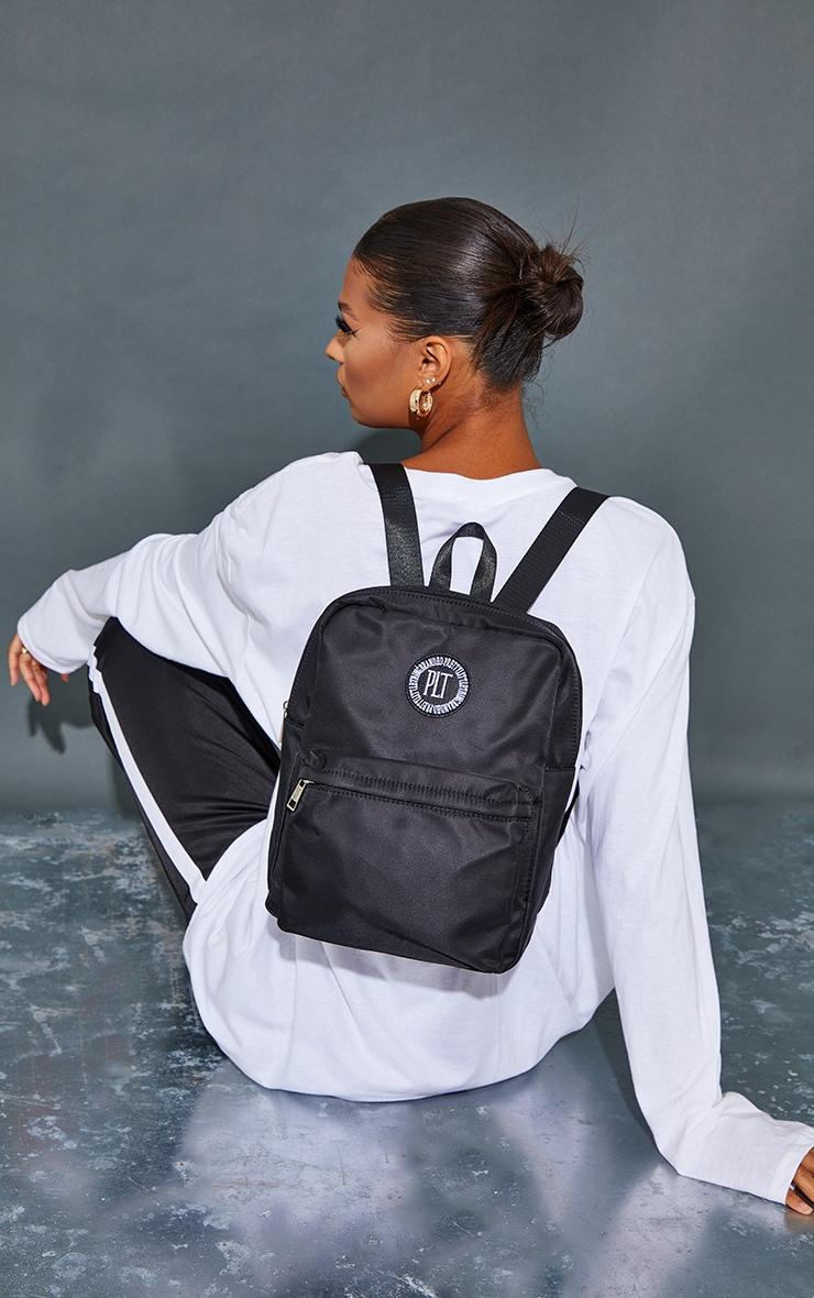 PRETTYLITTLETHING Black Round Badge Backpack 1