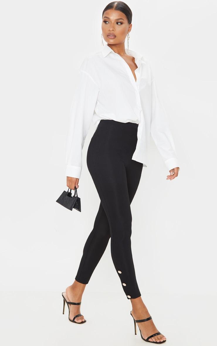 black-button-hem-detail-leggings by prettylittlething