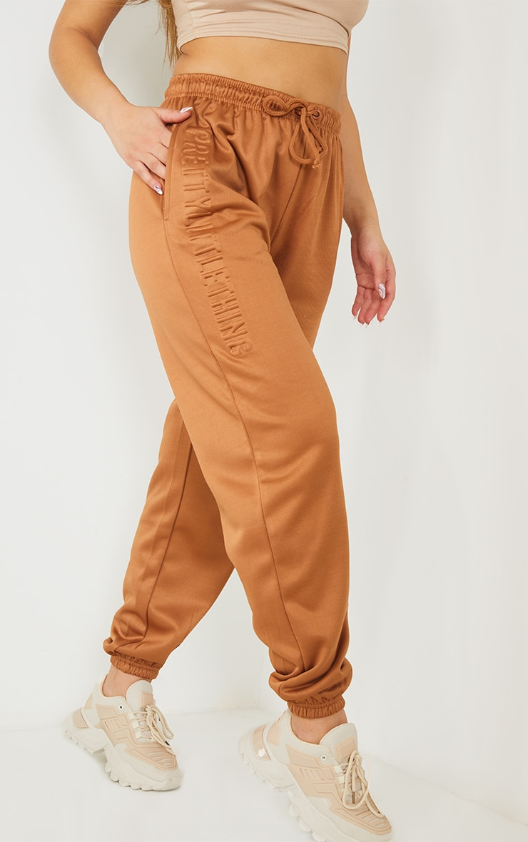PRETTYLITTLETHING Brown Scuba Embossed Joggers 2