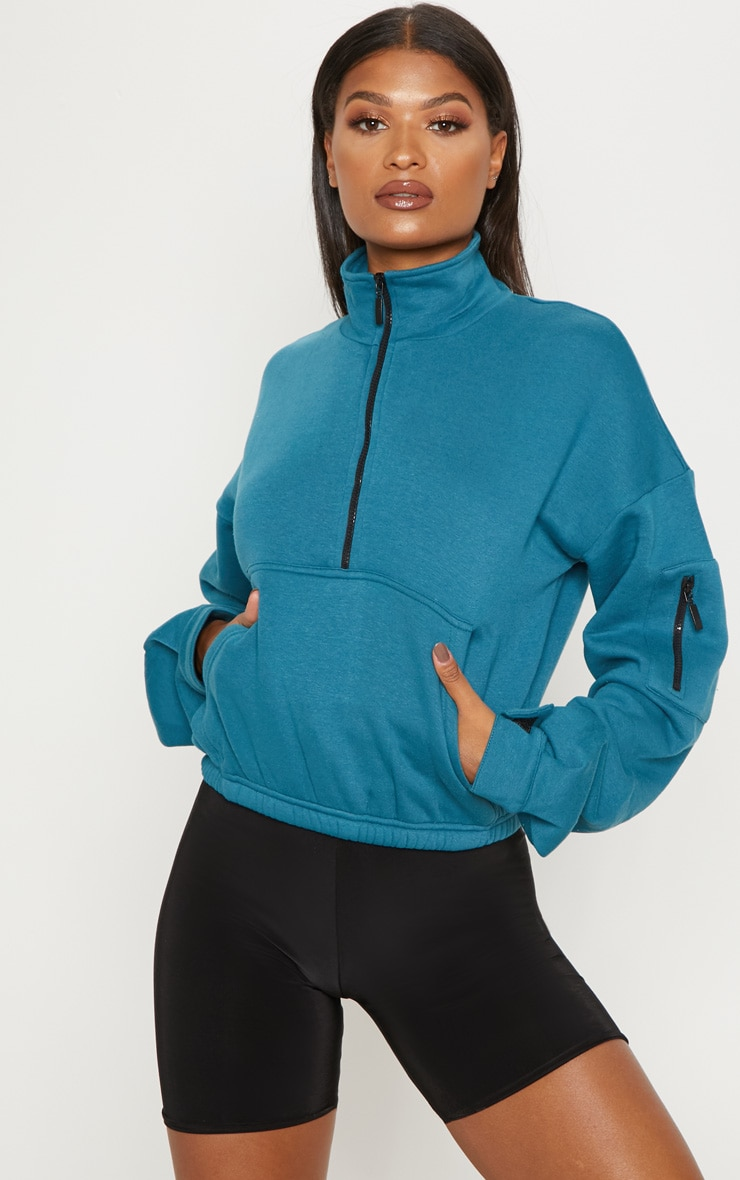 Sweat oversized bleu à zip frontal 1