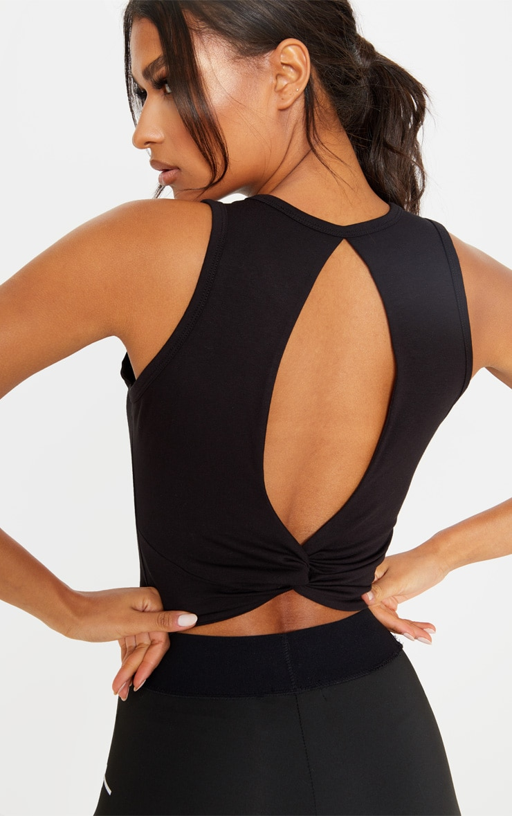PRETTYLITTLETHING Black Knot Back Cropped Gym Top 1