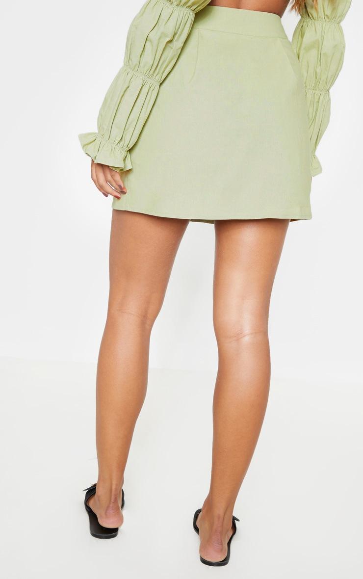 Mini-jupe vert menthe en coton à boutons devant 4