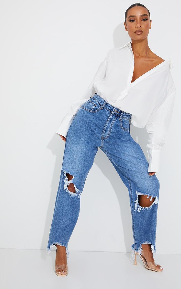 PRETTYLITTLETHING Mid Blue Wash Extreme Ripped Hem Boyfriend Jeans 1