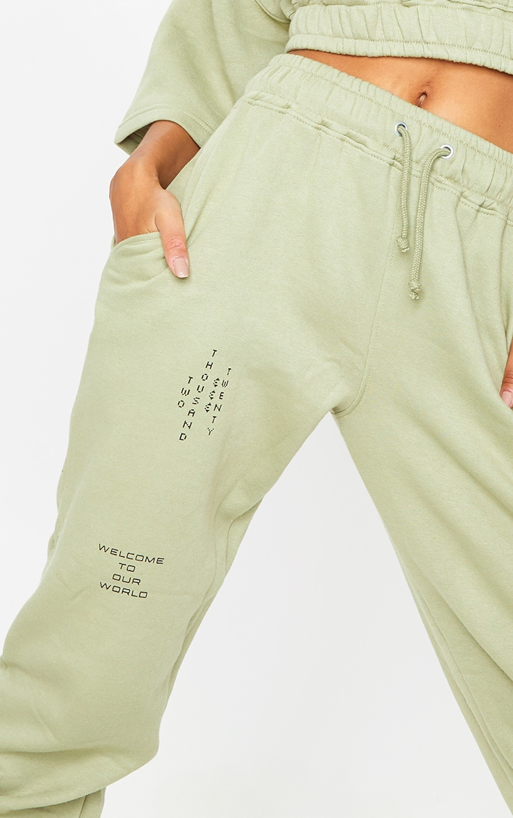PRETTYLITTLETHING Olive Green Welcome To Our World Slogan Joggers 4