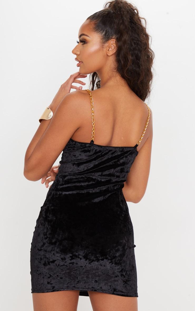 Robe moulante noire en velours avec bretelles chaîne  2
