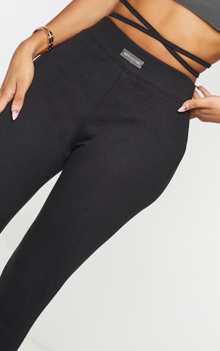 PRETTYLITTLETHING Shape Black Rib Badge Detail Ruched Bum Leggings 4