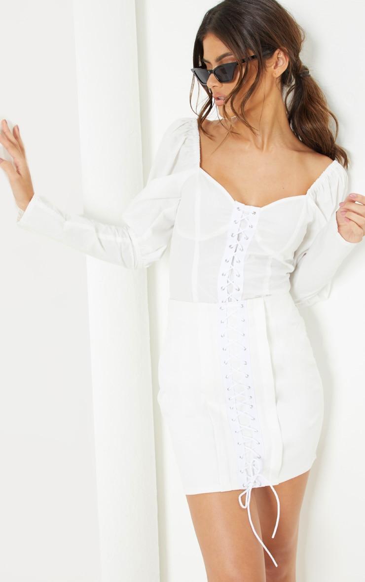 Mini-jupe blanche à détail lacets 1